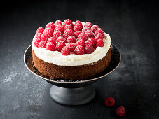 Nut cake with cream and raspberries