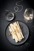 Black salsify cooked in parchment paper with orange zest
