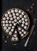 Chocolate tart with chocolate mousse and flambé meringues