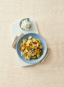 Strascinati with artichokes, salty ricotta and pine nuts