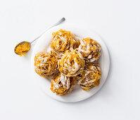 Nidi di tagliatelle all'arancia (deep fried pasta nests, Italy)