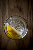 Water with ice and lemon wedge from top