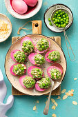 Eggs dyed in beetroot juice filled with spinach, peas and feta