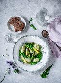 Asparagus stock with wild garlic and semolina dumplings and peas