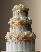 Easter Celebrations, three tiered white and teal striped wedding cake with camelia sugared flowers