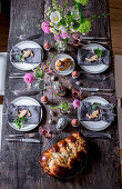A rustic table laid for Easter