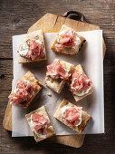 Rustic pizza with stacciatella and raw ham