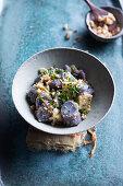 Purple potato salad with miso, green apples and peanuts