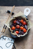 Grilled tomatoes and beetroot with soy sauce and sesame seeds (Asia)