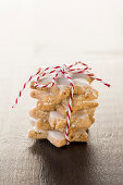 A stack of cinnamon stars tied with string