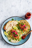 Tinga tacos (with chicken and onions) with chili sauce