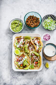 Lentils tacos with lattuce, onions, cream and guacamole sauce