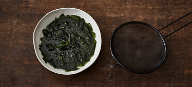 Dried wakame being softened in water