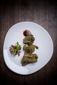 Venison tikka on a serving platter (India)