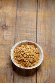 Soya flakes in a wooden bowl