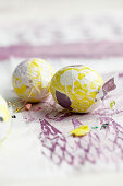 Easter eggs wrapped in colourful paper