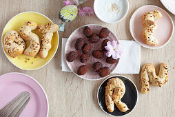 Chocolate date eggs and bread rolls shaped like letters for Easter