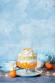 Tangerine trifle on concrete background