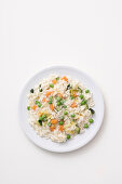 Vegetable risotto with leeks, peas, carrots and zucchini