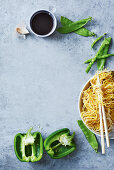 Soy sauce, mangetout, pasta and peppers