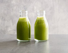 Exotic green smoothies made from spinach, pineapple and cashew nut mousse with coconut water