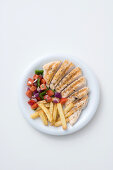 Roasted chicken breast with peppers and tomato salsa and french fries