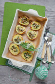 Baked potatoes with wild garlic and sheep's cheese