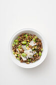Fava bean salad with cooked and raw fava beans, spelt and parmesan