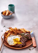 Portuguese-style steak with egg and chips