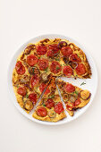 Frittata with grilled onions, tomatoes and rosemary