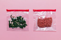 Minced meat and spinach leaves being frozen