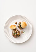 Beef medallions with mushrooms and a puff pastry topping