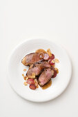 Duck breast in a honey and wine sauce with grapes and almonds
