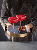 Pretzel balls with vanilla salt with pomegranate martinis