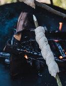 Campfire bread over a fire