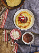 Pancakes with chocolate cream and grated coconut