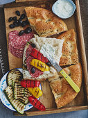 Stuffed unleavened bread with antipasti