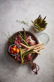 Pickled asparagus with prosciutto and grissini