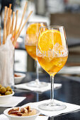 An aperitif with olives, almonds and grissini