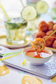 Acras de morue (stockfish balls, Caribbean) with a dip and a mojito