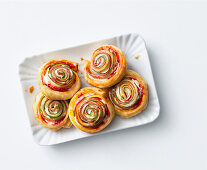 Puff pastries with ham, cheese and courgette