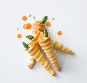 Asparagus cream in pastry cones
