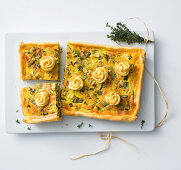 Mange tout and spring onion tart with smoked bacon and cheese flowers