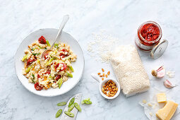 Risotto with dried tomatoes, pine nuts and spring onions