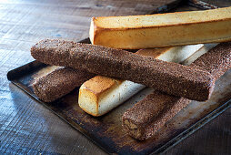 Square loaves on a baking tray, white bread and wholemeal bread