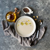 Ajo blanco, spanish typical cold soup, made of almonds and garlic with olive oil and bread