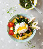 A polenta bowl with chard, a poached egg, turkey and pesto