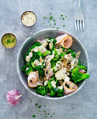 Broccoli salad with dressing and turkey breast