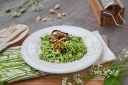 Wild garlic spaetzle with parmesan and onion rings