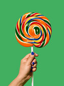 Hand holding large lollipop